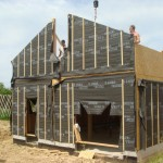 maison ossature bois, ossature bois, charpente traditionnelle, couverture en tuiles terre cuite, bardage douglas naturel, maisons ossature bois performantes